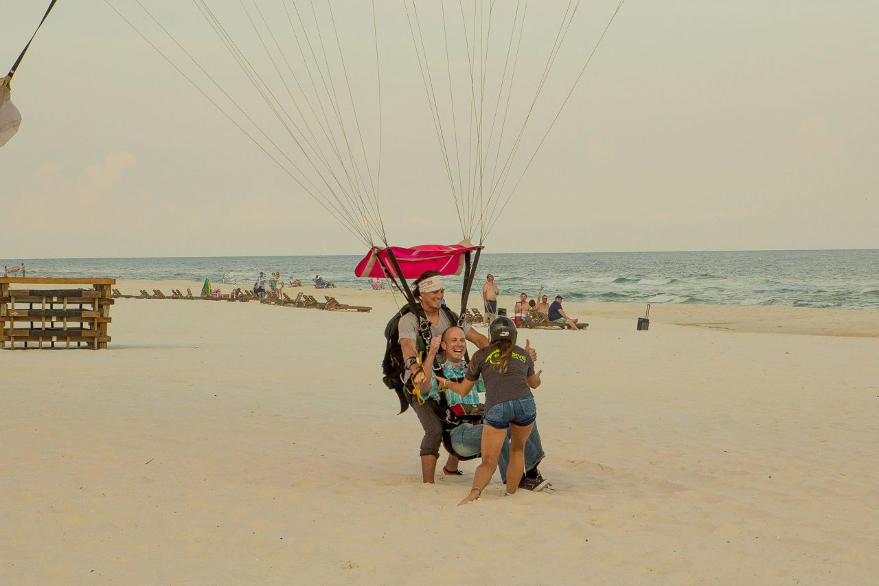 Male tandem skydiver enjoys beach skydiving with the skydive the gulf team