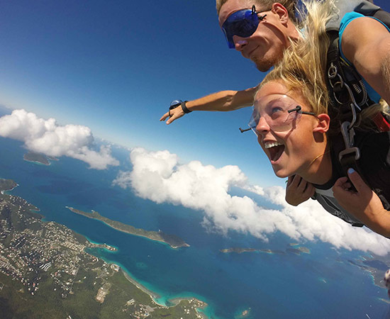 Women experiences the thrill of beautiful emerald coast skydiving