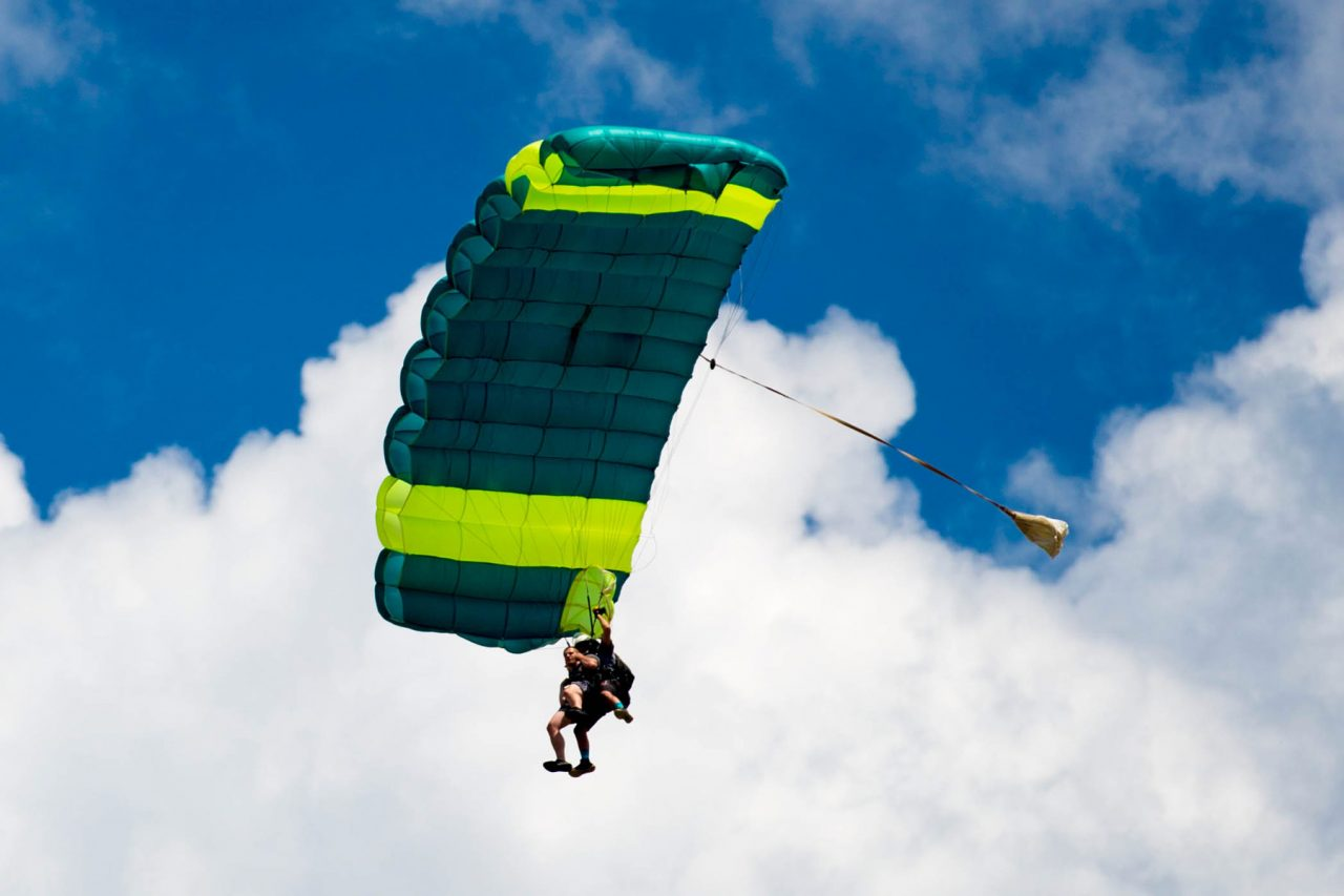 tandem skydiver enjoying the canopy ride portion of his skydive
