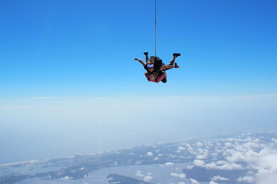 Women wearing pink shirt enjoys emerald coast skydiving with skydive the gulf