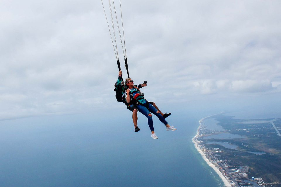 women skydiving over emerald coast