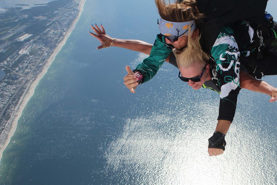 Women experiences the beautiful views of skydiving over the gulf shores