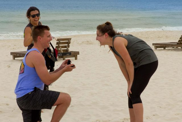 young man proposes to women after an awesome beach landing skydive