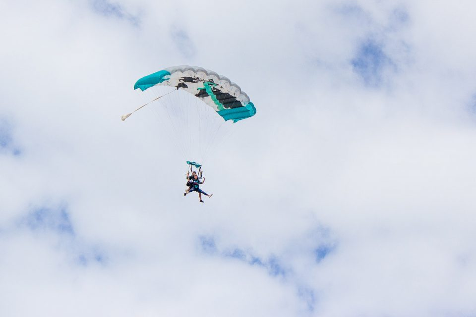 Tandem skydiver enjoying the canopy portion of her skydive at skydive the gulf
