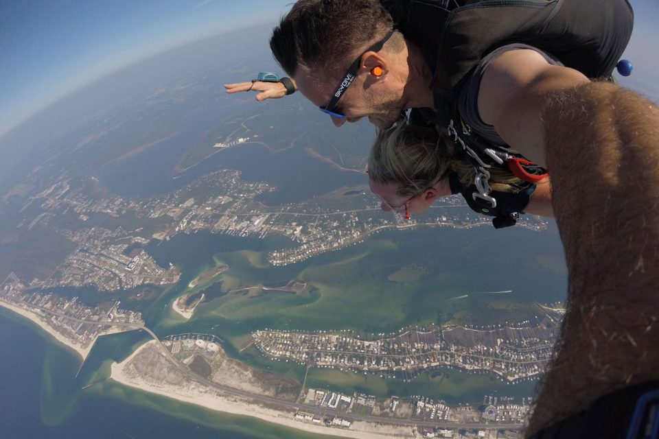 Female enjoying her tandem skydive over the gulf shores